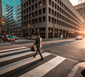 Man crossing the road zebra crossing